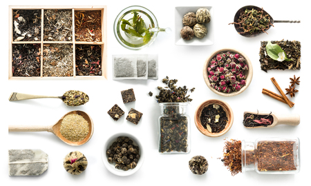 Foto de Various kinds of tea, rustic dishware, cinnamon, topview - Imagen libre de derechos