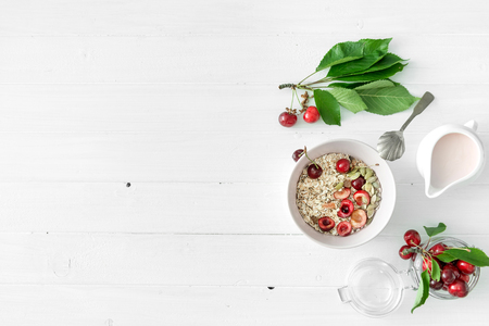 Photo pour oats with cherries, nuts, yogurt, copyspace, topview - image libre de droit