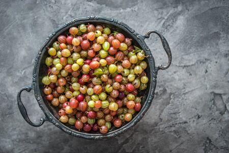 Photo pour bowl full of fresh ripe gooseberries, copyspace, topview - image libre de droit