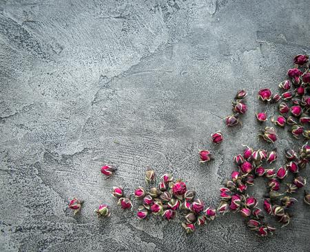 Photo pour Little buds of dog roses scattered, copyspace, topview - image libre de droit