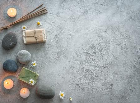Photo pour Pebbles, handmade rustic soap with chamomile, topview, copyspace - image libre de droit