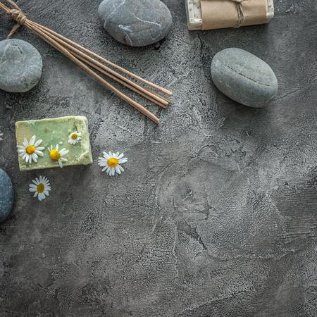 Photo pour Hot massage pebbles, soap for bathing, topview, copyspace - image libre de droit