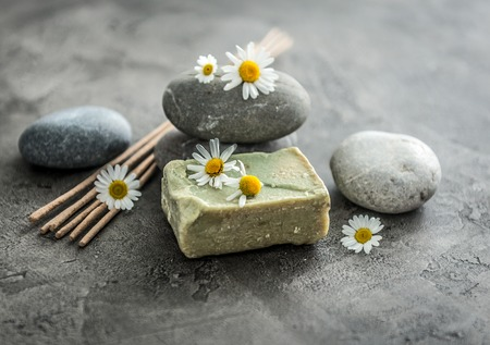 Photo for Handmade soap with chamomile, smoking lavender sticks - Royalty Free Image