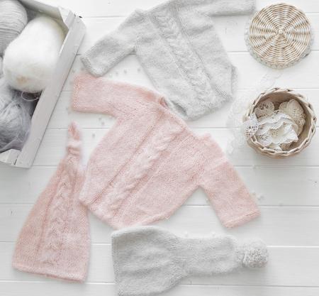 Photo pour pink and gray clothes for infant, handmade, topview - image libre de droit