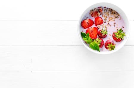 Photo pour bowl of granola with strawberries, textspace left, topview - image libre de droit