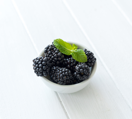 Photo for Blackberry on a wooden background - Royalty Free Image