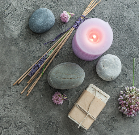 Photo pour Handmade soap with flowers, pebbles and spiritual smoking sticks, copyspace, topview - image libre de droit