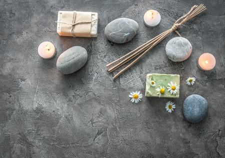 Photo pour Hot massage pebbles, handmade soap for a calming bath, smoking ritual sticks, topview, copyspace - image libre de droit