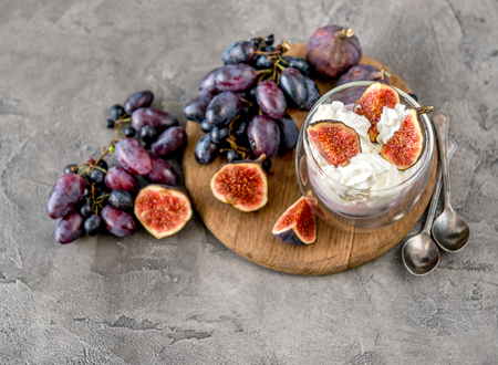 Photo for An useful dessert - yogurt, muesli and figs with grapes - Royalty Free Image