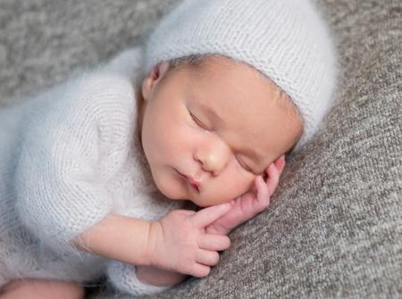 Photo pour Portrait of newborn baby boy sleeping - image libre de droit