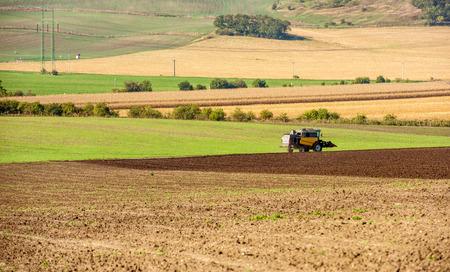 Photo pour Tractor plowing the field - image libre de droit
