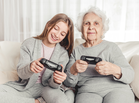 Photo for Grandmother with granddaughter playing games - Royalty Free Image
