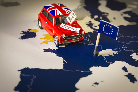 Foto de Red vintage car with Union Jack flag and brexit or bye words over an UE map and flag. - Imagen libre de derechos