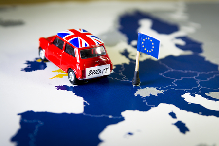 Photo for Red vintage car with Union Jack flag and brexit or bye words over an UE map and flag. - Royalty Free Image