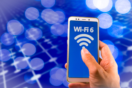 Foto de Smartphone with new wifi 6 on the screen. - Imagen libre de derechos