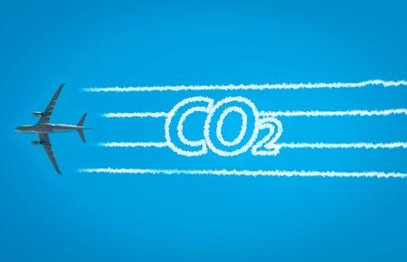 Foto de Airplane leaving jet contrails with CO2 word inside - Imagen libre de derechos
