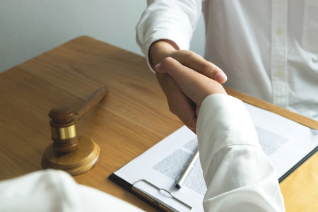 Foto de Lawyer handshake. Lawyer people shaking hands with client, finishing up a meeting,Success agreement negotiation. - Imagen libre de derechos
