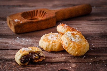 Photo for Maamoul or mamoul - arabic cookies stuffed dates with coconut near wooden mold on vintage wooden table background. Selective focus. Toned image - Royalty Free Image