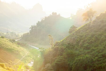 Photo pour Picturesque mountains road at dusk, glowing sunset shines on curve asphalt road and mountain valley, aerial view scenery along the mountain road to Luang Prabang, North Laos. - image libre de droit
