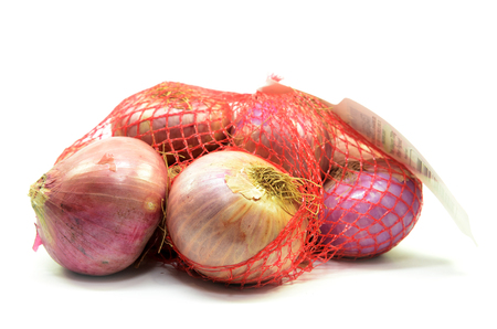 Foto de Pack of red onions isolated on white background - Imagen libre de derechos