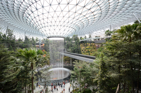 Photo pour SINGAPORE, 11 Apr, 2019: The Rain Vortex, a 40m-tall indoor waterfall located inside the Jewal Changi Airport in Singapore. Jewel Changi Airport is set to open on April 17, 2019. - image libre de droit