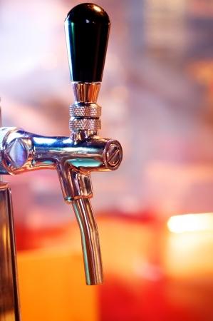 Foto de Beer tap close up background - Imagen libre de derechos