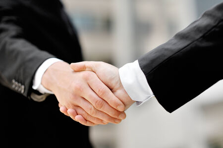 Photo for two businessmen shaking hands - business deal partnership concept - Royalty Free Image