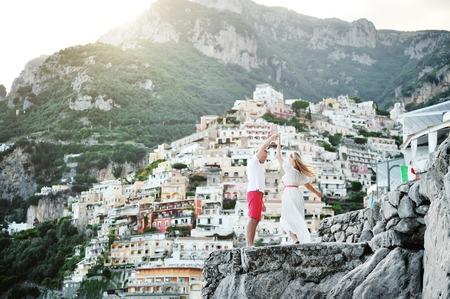 Photo for young beautiful happy couple dancing in Positano, Amalfi coast, Italy - Royalty Free Image