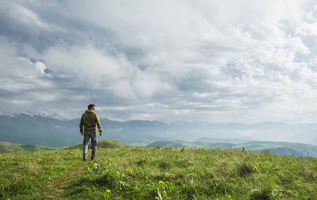 Photo for Beautiful landscape, man standing on the hill in front of mountains - Royalty Free Image