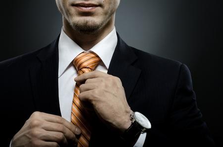 portrait the beautiful businessman in black costume tie one