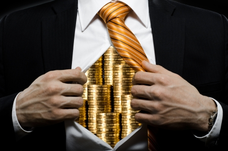 venality businessman or banker in black costume throw open one\'s shirt packed heap gold money