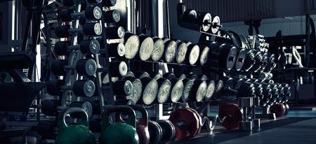 gym indoor interior with dumbbells;  horizontal panorama photo, blue tone