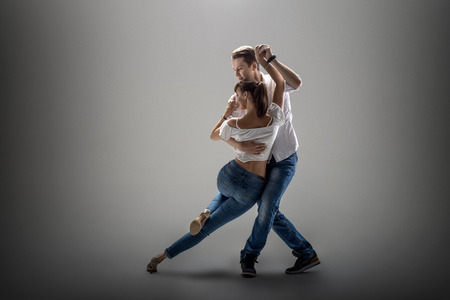 Photo for beauty couple dancing social danse ( kizomba or bachata or semba or taraxia) , on grey background - Royalty Free Image