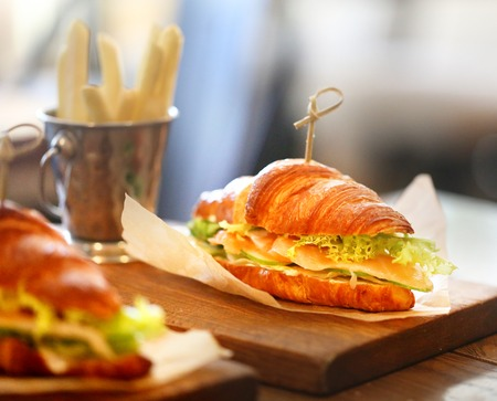 Photo for Macro photo tasty big sandwiches, fish and chips in a cafe - Royalty Free Image