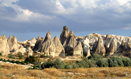 Photo pour Photo of beautiful landscape views of the mountains of Cappadocia in Turkey on a sunny afternoon autumn - image libre de droit