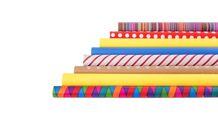 Foto de Rolls of multi-colored wrapping paper on a white background. - Imagen libre de derechos