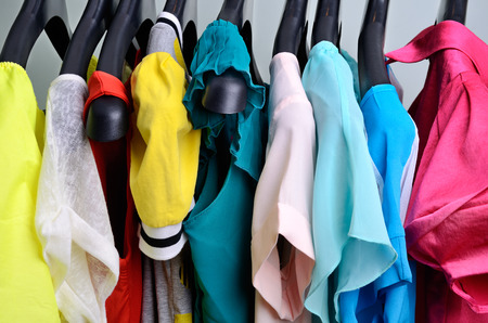 Photo pour multicolored womens clothing hanging on the hanger verticalclothing pastel colors hanging on the hanger horizontal - image libre de droit