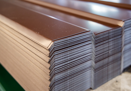 Photo pour Sheets of the profile sheet are stacked in a warehouse rack - image libre de droit