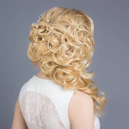 Photo pour beautiful young girl in the image of the bride, beautiful wedding hairstyle with flowers in her hair, hairstyle for bride - image libre de droit