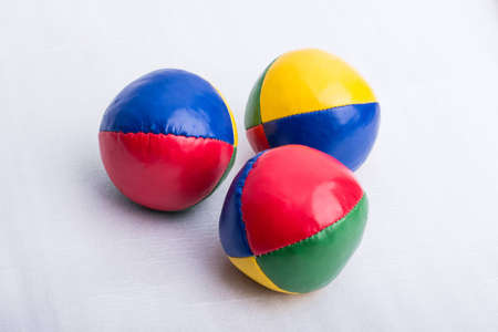 Foto de A set of three colorful juggling balls on a white surface. - Imagen libre de derechos