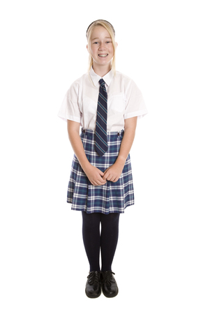 Foto de A full length image of a high school student standing with her face to the camera. - Imagen libre de derechos