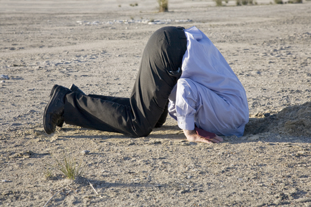 Photo pour A powerful denial concept, man with his head in the sand. - image libre de droit