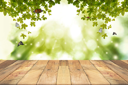 Photo for Brown Wooden table with green blurred  background. Empty table for display product. - Royalty Free Image