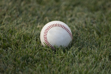 A baseball sits on the grass