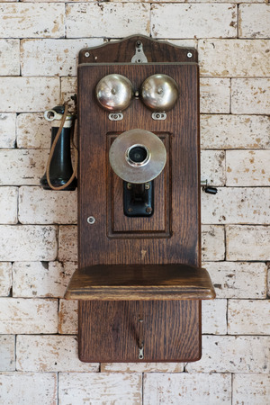 Photo for old telephone hanging on brick wall - Royalty Free Image
