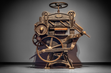 Foto de Antique printing press over grey background with vignette. - Imagen libre de derechos