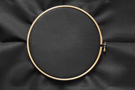 Foto de Black blank canvas on wooden round frame as a background - Imagen libre de derechos