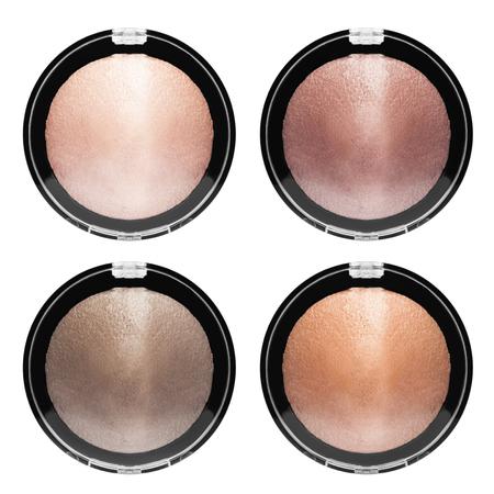Foto de Four shimmer face beauty products on white background - Imagen libre de derechos