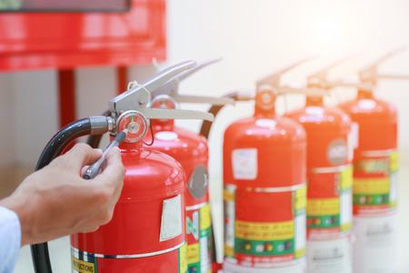 Photo pour Engineer inspection Fire extinguisher and fire hose. - image libre de droit