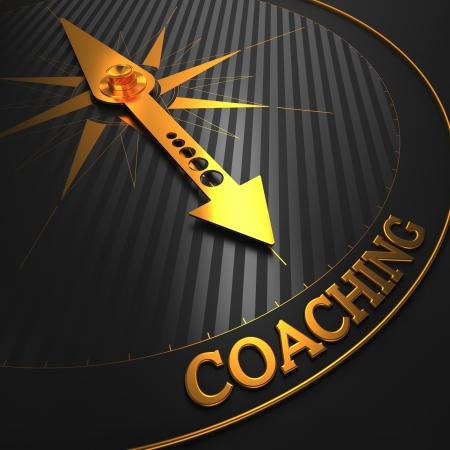 Foto de Coaching - Business Background. Golden Compass Needle on a Black Field Pointing to the Word Coaching. 3D Render. - Imagen libre de derechos